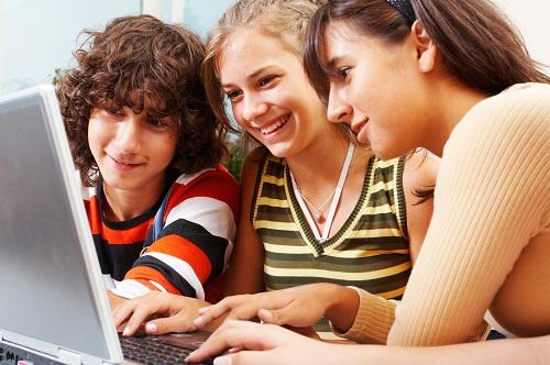 Three teenagers on laptop